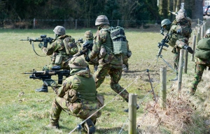 Geesteren, Netherlands - March 25, 2013: A battalion of soldiers with automatic weapons during a training of special forces of the Dutch army on a cold day in March. The training was called 'Cerberus Guard' and about a thousand soldiers and the air force worked together. The training took place in the open field between farmes and in small villages, March 25, 2013 in the Netherlands.